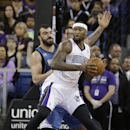 Sacramento Kings center DeMarcus Cousins right, goes to basket against Minnesota Timberwolves center Nikola Pekovic, of Montenegro, during the first quarter of an NBA basketball game in Sacramento, Calif., Saturday, March 1, 2014 The Associated Press