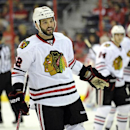 File-This Sept. 20, 2013, file photo shows Chicago Blackhawks left wing Brandon Bollig (52) reacting during the first period an NHL preseason hockey game against the Washington Capitals in Washington. Bollig was traded to the Calgary Flames on Saturday,