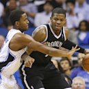 Brooklyn Nets' Joe Johnson, right, looks for a way to the basket around Orlando Magic's Maurice Harkless, left, during the second half of an NBA basketball game in Orlando, Fla., Wednesday, April 9, 2014. Orlando won 115-111 The Associated Press