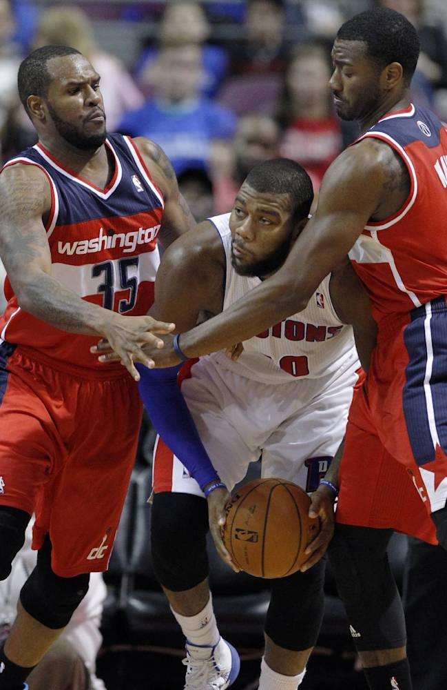 Detroit Pistons center Greg Monroe, center, is trapped in a corner by Washington Wizards forward Trevor Booker (35) and guard John Wall during the first half of a preseason NBA basketball game Tuesday, Oct. 22, 2013, in Auburn Hills, Mich