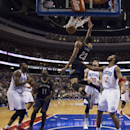 New Orleans Pelicans' Anthony Davis, center, dunks the ball with Philadelphia 76ers' Evan Turner, right, and Spencer Hawes, center right, by him during the fourth quarter of an NBA basketball game Friday, Nov. 29, 2013, in Philadelphia. The Pelicans won