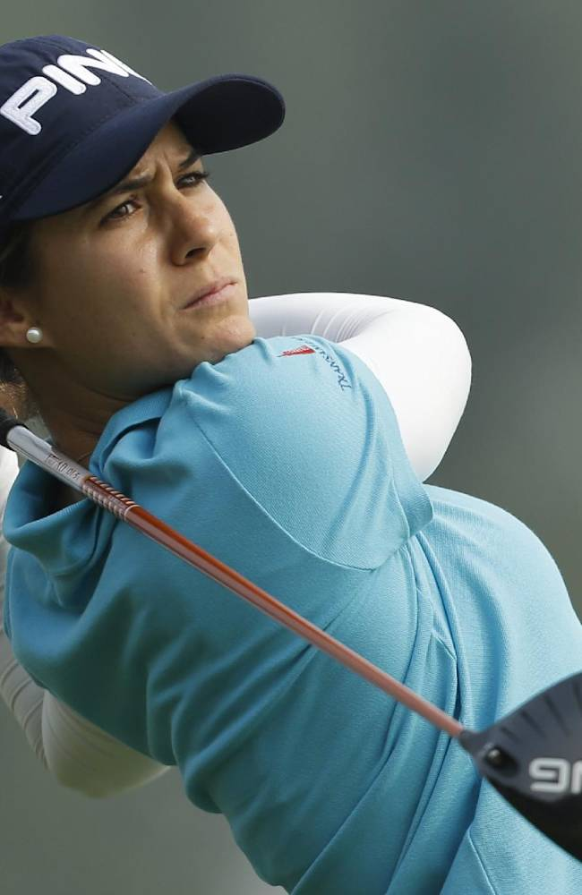Spain's Azahara Munoz tees off on the 16th hole during the second round of the Reignwood LPGA Classic golf tournament at Pine Valley Golf Club on the outskirts of Beijing, China, Friday, Oct. 4, 2013