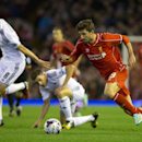 Liverpool's Fabio Borini, right, keeps the ball from Swansea's Angel Rangel, bottom centre, and Jonjo Shelvey during the English League Cup soccer match between Liverpool and Swansea at Anfield Stadium, Liverpool, England, Tuesday Oct. 28, 2014