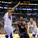 Los Angeles Clippers forward Glen Davis (0) guards Atlanta Hawks forward Elton Brand (42) as he looks for the shot after getting by forward Hedo Turkoglu (8), of Turkey, in the second half of an NBA basketball game, Saturday, March 8, 2014, in Los Angeles