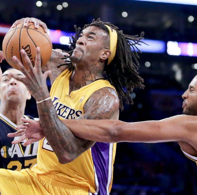 Utah Jazz forward Brian Cook, right, fouls Los Angeles Lakers center Jordan Hill, as Rudy Gobert, left, looks on during the second half of a preseason NBA basketball game in Los Angeles, Tuesday, Oct. 22, 2013