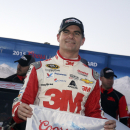 Jeff Gordon poses for photos after winning the pole position during qualifying for Sunday's NASCAR Sprint Cup Series auto race, Friday, March 6, 2015, in Las Vegas. (AP Photo/Isaac Brekken)