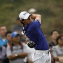 Rory McIlroy of Northern Ireland tees off on the eighth hole during the final round of the BMW Masters 2012 golf tournament at Lake Malaren Golf Club in Shanghai October 28, 2012. REUTERS/Aly Song