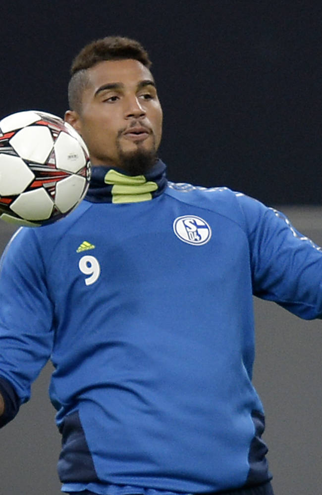 Schalke's Kevin-Prince Boateng of Ghana  exercises during the last training session prior the Champions League Group E soccer match between FC Schalke 04 and Steaua Bucharest in Gelsenkirchen, Germany, Tuesday, Sept. 17, 2013