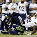 Seattle Seahawks cornerback Phillip Adams, left, tackles San Diego Chargers tight end Ladarius Green (89) in the first half of a preseason NFL football game, Friday, Aug. 15, 2014, in Seattle The Associated Press