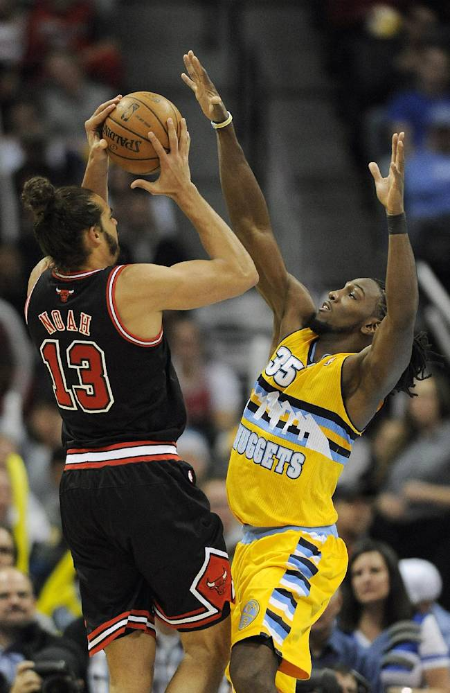 Denver Nuggets forward Kenneth Faried, right, guards Chicago Bulls center Joakim Noah, left, in the second half of an NBA basketball game on Thursday, Nov. 21, 2013, in Denver. The Nuggets won 97-87