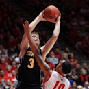 South Dakota State's Nate Wolters, left, scores against New Mexico's Kendall Williams in the second half of an NCAA college basketball game in Albuquerque, N.M., Saturday, Dec. 22, 2012. South Dakota State won 70-65. (AP Photo/Eric Draper)
