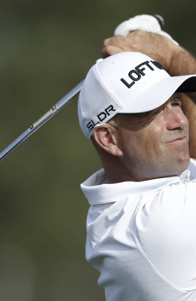 Stewart Cink watches his tee shot on the 17th hole of the north course during the first round of the Farmers Insurance Open golf tournament Thursday, Jan. 23, 2014, in San Diego