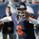 Chicago Bears quarterback Jay Cutler (6) throws a pass in the first half of an NFL football game against the Green Bay Packers Sunday, Sept. 28, 2014, in Chicago. The Associated Press