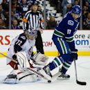 Columbus Blue Jackets' goalie Sergei Bobrovsky, left, of Russia, makes the save as Vancouver Canucks' Ryan Kesler screens him during first period NHL hockey action in Vancouver, British Columbia, Friday, Nov. 22, 2013 The Associated Press