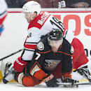 The Ducks' Andrew Cogliano tries to get out from under the Hurricanes' Jay McClement during the first period of their hockey game at Honda Center Tuesday night Feb. 3, 2015 The Associated Press