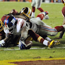New York Giants running back Andre Brown (35) stretches for a touchdown over Washington Redskins defensive back Trenton Robinson, left, during the second half of an NFL football game Sunday, Dec. 1, 2013, in Landover, Md The Associated Press