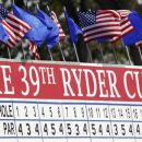 Flags fly on the main scoreboard during a practice round at the 39th Ryder Cup golf matches at the Medinah Country Club in Medinah, Illinois, September 26, 2012. REUTERS/Matt Sullivan