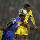 Shrewsbury's Jermaine Grandison, left, and Chelsea's Didier Drogba head the ball, during the fourth round of the English League Cup soccer match between Shrewsbury Town and Chelsea at Greenhous Meadow, Shrewsbury, England, Tuesday, Oct. 28, 2014