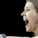 Michigan coach Kim Barnes Arico yells to her team during the first half of an NCAA college basketball game against Indiana in the Big Ten Conference tournament in Hoffman Estates, Ill., on Thursday, March 7, 2013. (AP Photo/Nam Y. Huh)