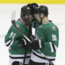 Dallas Stars centers Tyler Seguin (91) and Jason Spezza (90) congratulate each other after an NHL hockey game against the Montreal Canadiens Saturday, Dec. 6, 2014, in Dallas. The Stars won 4-1 The Associated Press