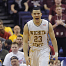 Wichita State's Fred VanVleet (23) celebrates a basket against Missouri State in the first half of an NCAA college basketball game in the semifinals of the Missouri Valley Conference men's tournament, Saturday, March 8, 2014, in St. Louis. (AP Photo/Bill Boyce)