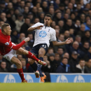 Tottenham Hotspur's Ezekiel Fryers, right, competes with Cardiff City's Craig Bellamy during their English Premier League soccer match at White Hart Lane, London, Sunday, March 2, 2014
