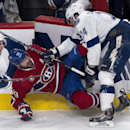 Montreal Canadiens' Andrei Markov is checked by Tampa Bay Lightning's Brett Connolly as he returns to his bench during the second period of an NHL hockey game Tuesday, Jan. 6, 2015, in Montreal The Associated Press