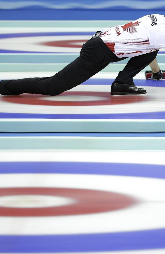 Canada's Pat Simmons delivers the stone during a semi-final match against Sweden at the 2014 World Men's Curling Championship held at the Capital Gymnasium in Beijing, China, Saturday, April 5, 2014