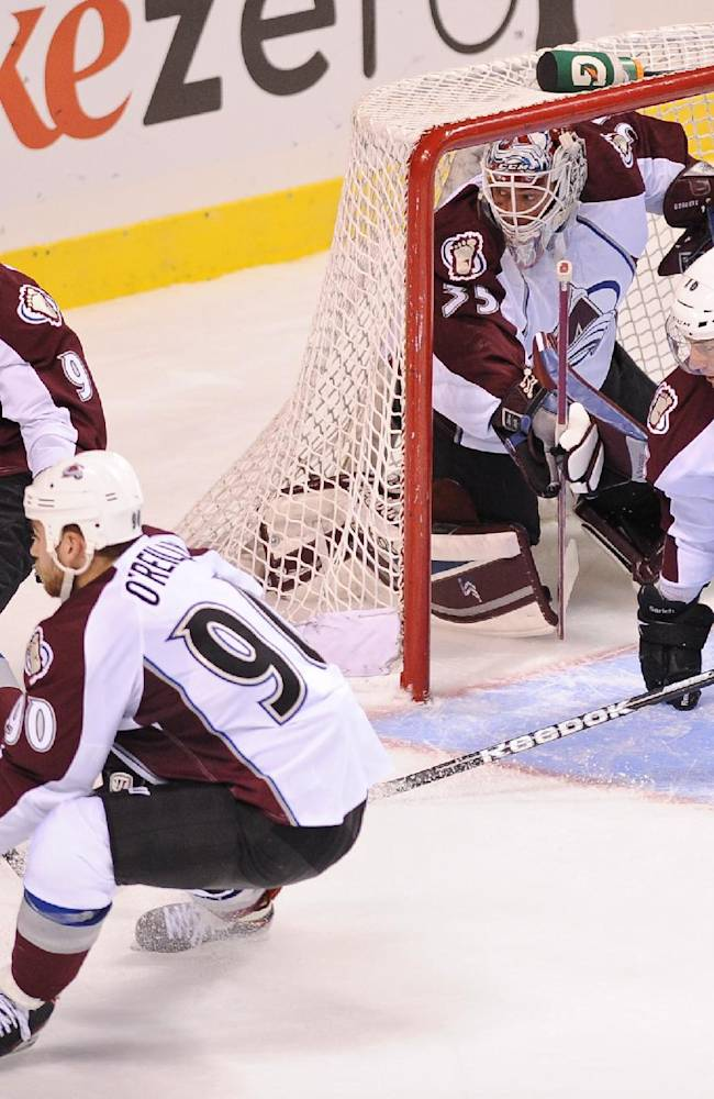 Matt Duchene (9), Ryan O'Reilly (90), Cory Sarich (16) and Jean-Sebastien Giguere (35) of the Colorado Avalanche protect the goal in the third period of an NHL preseason hockey game against the Los Angeles Kings, Saturday, Sept. 28, 2013, in Las Vegas. The Avalanche won 3-2