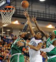 Philadelphia 76ers forward Lavoy Allen (50) tries to score against Boston Celtics forwards Jared Sullinger (7) and Gerald Wallace (45) in the first quarter of a preseason NBA basketball game Friday, Oct 11, 2013, in Newark, Del. (AP Photo/Steve Ruark)
