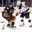 Anaheim Ducks' Devante Smith-Pelly (12) vies for the puck with New Jersey Devils Adam Henrique (14) during the second period of an NHL hockey game, Friday, Jan. 16, 2015, in Anaheim, Calif The Associated Press