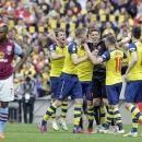 Arsenal players celebrate after winning the English FA Cup final soccer match between Aston Villa and Arsenal at Wembley stadium in London, Saturday, May 30, 2015. Arsenal won the match 4-0. (AP Photo/Alastair Grant)