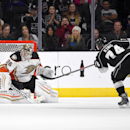 Los Angeles Kings left wing Dwight King, right, scores on Anaheim Ducks goalie John Gibson during the shootout in a preseason NHL hockey game, Thursday, Sept. 25, 2014, in Los Angeles. The Kings won 4-3. The Associated Press