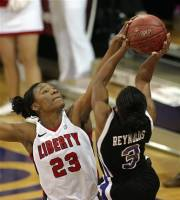 High Point's Erin Reynolds (3) puts up a shot as Liberty's Avery Warley defends during the first half of an NCAA college basketball game in the final of the Big South women's tournament, Sunday, March 11, 2012, in High Point, N.C. (AP Photo/Rick Havner)