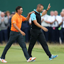 Runners up Sergio Garcia of Spain, right, and Rickie Fowler of the US acknowledge the crowd as they walk to receive their prizes at the British Open Golf championship at the Royal Liverpool golf club, Hoylake, England, Sunday July 20, 2014