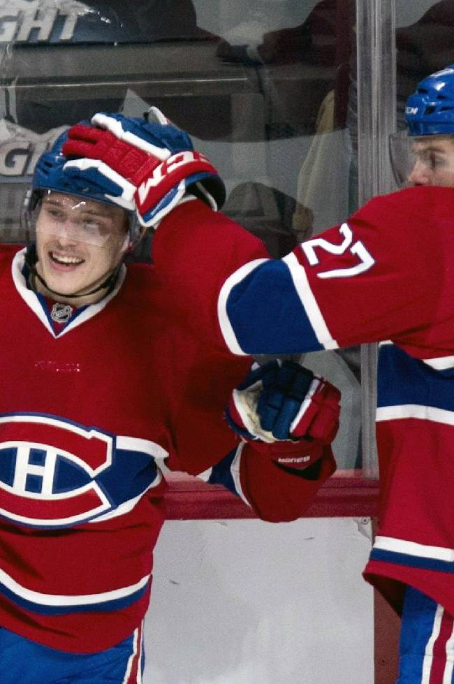 Montreal Canadiens' Brendan Gallagher, left, is congratulated by teammate Alex Galchenyuk following a goal against the New York Islanders during second period of an NHL hockey game Sunday, Nov. 10, 2013, in Montreal