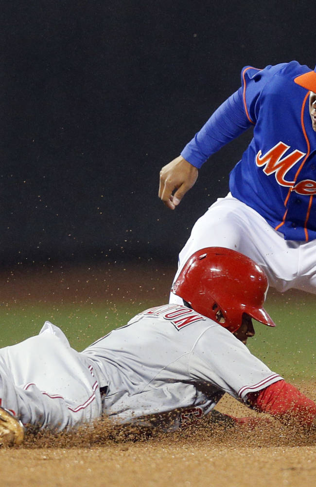 New York Mets shortstop Ruben Tejada (11) tags out Cincinnati Reds Billy Hamilton who was trying to steal second base in the eighth inning of a baseball game at Citi Field in New York, Friday, April 4, 2014. The Mets won 4-3