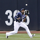 San Diego Padres center fielder Cameron Maybin makes a running catch on a deep fly hit by New York Mets' Kirk Nieuwenhuis in the second inning of a baseball game Saturday, July 19, 2014, in San Diego. (AP Photo/Lenny Ignelzi)