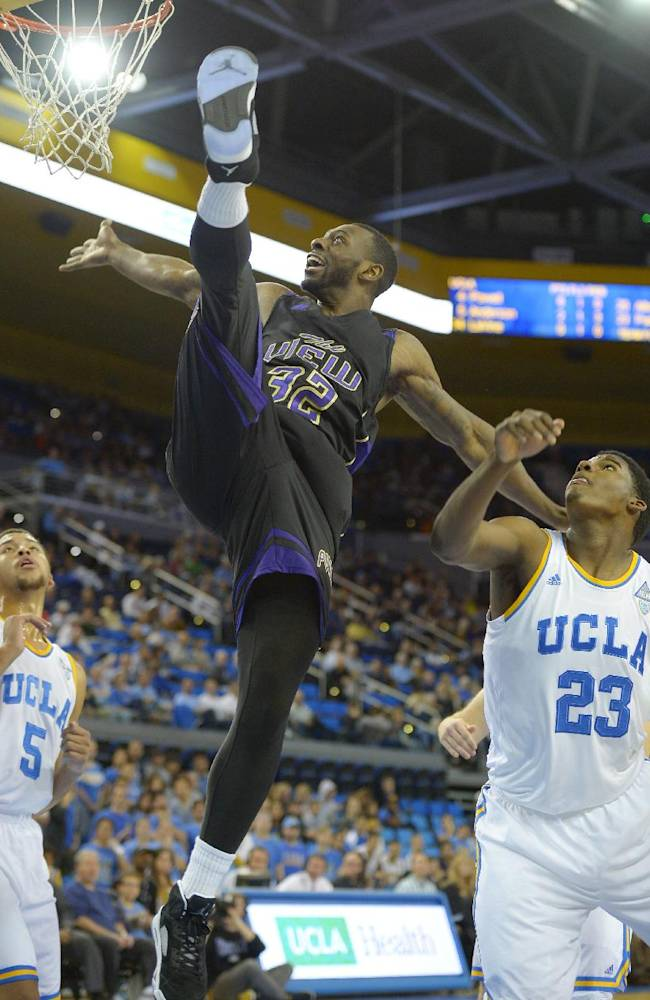 Prairie View forward Demondre Chapman, center, looses control and falls after putting up a shot as UCLA guard Kyle Anderson (5) and center Tony Parker (23) look on during an NCAA college basketball game, Saturday, Dec. 14, 2013, in Los Angeles