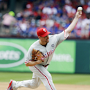 Philadelphia Phillies starting pitcher Cliff Lee delivers the ball during the third inning of an opening day baseball game against the Texas Rangers at Globe Life Park, Monday, March 31, 2014, in Arlington, Texas The Associated Press