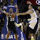 Golden State Warriors' Stephen Curry, right, passes away from San Antonio Spurs' Boris Diaw (33) during the first half of an NBA basketball game, Thursday, Dec. 19, 2013, in Oakland, Calif. (AP Photo/Ben Margot)