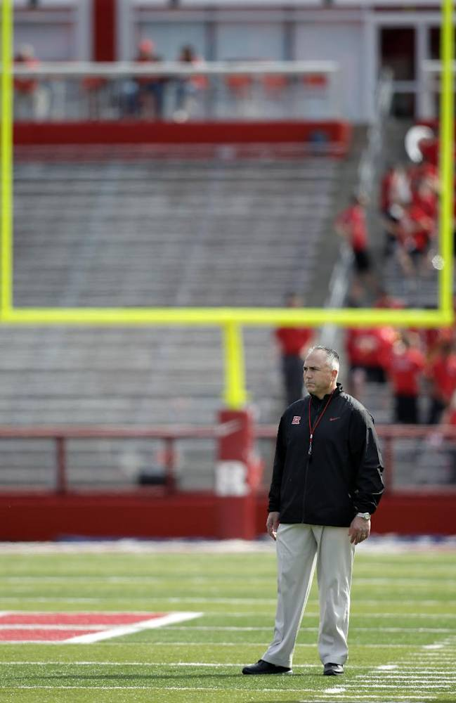 Rutgers head coach Kyle Flood stands on the field during their spring NCAA college football game in Piscataway, N.J., Saturday, April 26, 2014