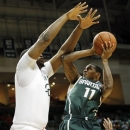 Michigan State's Keith Appling (11) shoots over Miami's Reggie Johnson (42) in the half of an NCAA college basketball game, Wednesday, Nov. 28, 2012, in Coral Gables, Fla. (AP Photo/Alan Diaz)