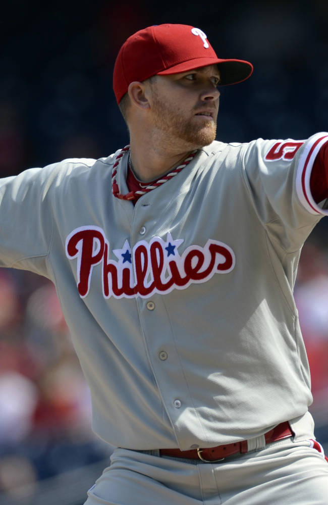Philadelphia Phillies starting pitcher Tyler Cloyd delivers against the Washington Nationals during the first inning of their baseball game at Nationals Park in Washington, Sunday, Sept. 15, 2013