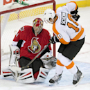 Philadelphia Flyers center Brayden Schenn, right, pressures Ottawa Senators goalie Craig Anderson as he makes a save during the second period of an NHL hockey game Tuesday, Nov. 12, 2013, in Ottawa, Ontario The Associated Press