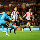 Tottenham Hotspurs' Jermain Defoe, left, has a shot towards goal past Sunderland's Wes Brown, center, and John O'Shea, right, during their English Premier League soccer match at the Stadium of Light, Sunderland, England, Saturday, Dec. 7, 2013