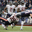 New England Patriots tight end Rob Gronkowski (87) carries Chicago Bears defensive back Al Louis-Jean (39) into the end zone as he scores a touchdown in the second half of an NFL football game against the Chicago Bears, Sunday, Oct. 26, 2014, in Foxboroug