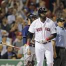 Boston Red Sox designated hitter David Ortiz tosses the bat as he watches his three-run home run against the Cleveland Indians during the third inning of a baseball game at Fenway Park in Boston, Thursday, May 23, 2013. (AP Photo/Charles Krupa)