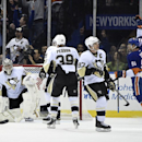 New York Islanders center John Tavares (91) celebrates right wing Kyle Okposo's goal as Pittsburgh Penguins goalie Marc-Andre Fleury (29), left wing David Perron (39) and center Sidney Crosby (87) react in the third period of an NHL hockey game at Nassau