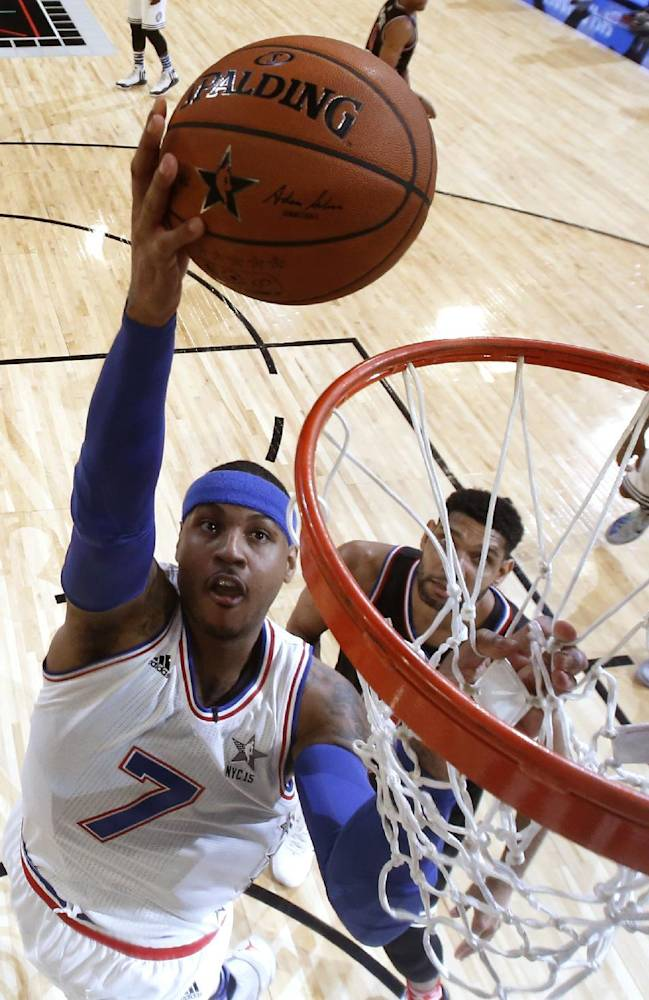 FILE - In this Feb. 15, 2015 file photo, East Team's Carmelo Anthony, of the New York Knicks, goes up for a shot during the first half of the NBA All-Star basketball game, in New York. The NBA star announced Thursday, June 11, 2015, that he is bringing a professional soccer team to Puerto Rico for the first time in three years. (AP Photo/Kathy Willens, File)